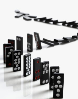 Falling Domino Pieces Arranged in a Line